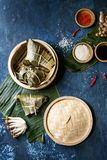 Rice piramidal dumplings. Asian rice piramidal steamed dumplings from rice tapioca flour with meat filling in banana leaves served in bamboo steamer. Ingredients royalty free stock photo