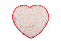 Rice in a plate in the form of heart Royalty Free Stock Image