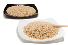 Rice in plates and chopsticks Royalty Free Stock Photography