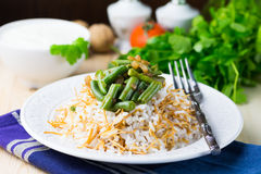 Rice plov with vermicelli, green beans and onions Stock Photos