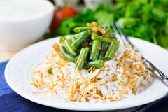 Rice plov with vermicelli, green beans and onions Royalty Free Stock Photos