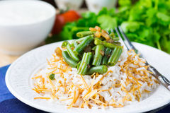 Rice plov with vermicelli, green beans and onions Royalty Free Stock Images