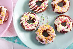 Rice pop doughnuts with white chocolate drizzle. And sprinkles Royalty Free Stock Photos