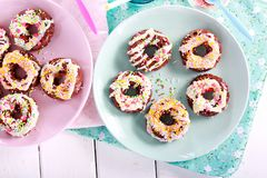 Rice pop doughnuts with white chocolate drizzle. And sprinkles Stock Photography