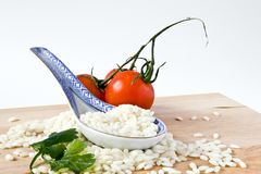 Rice and porcelain spoon Royalty Free Stock Photo