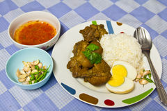 Rice, pork and eggs. Pork with rice, boiled eggs, hot Royalty Free Stock Images