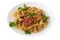 Rice with pork and sausages Royalty Free Stock Photography