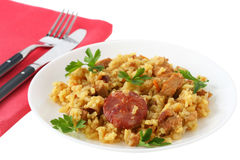 Rice with pork, sausages Stock Image