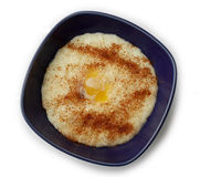Rice porridge with cinnamon, sugar and butter stock photos