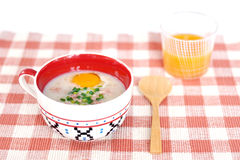 Rice porridge with egg in cute bowl Royalty Free Stock Photos