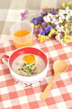 Rice porridge with egg in cute bowl Stock Photo