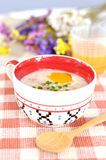 Rice porridge with egg in cute bowl Stock Image
