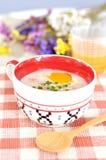 Rice porridge with egg in cute bowl Stock Image