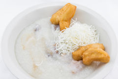 Rice porridge with with fried pastries in Thai style Stock Image