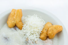 Rice porridge with with fried pastries in Thai style Stock Photos