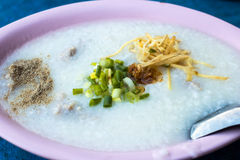 Rice porridge, or jook in pink bowl Royalty Free Stock Photography
