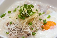 Rice porridge, or jook in white bowl Royalty Free Stock Photo