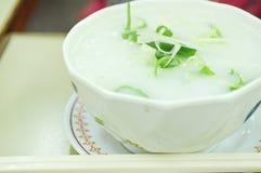 Rice porridge, jook in white bowl stock photography