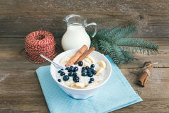 Rice porridge with milk, cinamon, banana and blueberry with Chri Stock Image