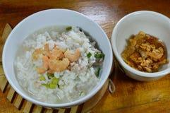 Rice porridge minced pork and dried shrimp with fried garlic on bowl Stock Photos