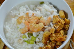 Rice porridge with minced pork and dried shrimp topping fried garlic on bowl Stock Image