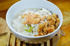 Rice porridge with minced pork and dried shrimp topping fried garlic on bowl Royalty Free Stock Images