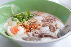 Rice porridge, rice gruel, congee rice soup with egg and pork Stock Images