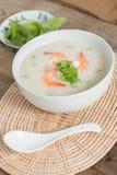 Rice porridge with shrimp in white bowl. Stock Photos