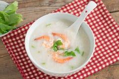 Rice porridge with shrimp in white bowl. Stock Images