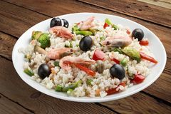 Rice porridge with shrimps and vegetables. royalty free stock image