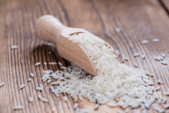 Rice. Portion of Rice on rustic wooden background (close-up shot stock image