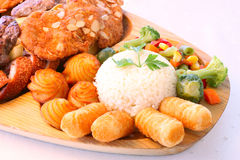 Rice, potatoes and meat plateau Stock Photos