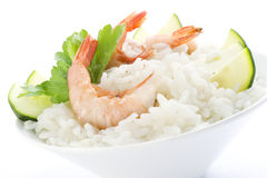 Rice with prawns and zucchini. On white background Royalty Free Stock Photos