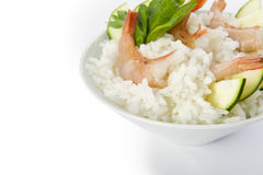 Rice with prawns and zucchini. On white background Royalty Free Stock Photo
