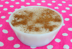 Rice pudding. Bowl on colorful background Royalty Free Stock Photography