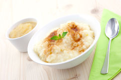 Rice pudding and apple puree Stock Photos