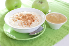 Rice pudding with apple sauce Stock Photos