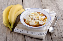 Rice pudding with banana slices Stock Photos