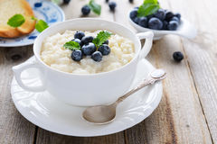 Rice pudding with blueberry decorated with mint leaf Stock Photo