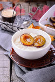 Rice pudding with caramel vanilla plums Royalty Free Stock Image