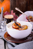 Rice pudding with caramel vanilla plums Royalty Free Stock Photos