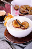 Rice pudding with caramel vanilla plums Stock Photo