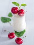 Rice pudding with cherries Royalty Free Stock Photography