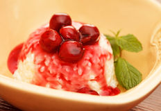 Rice pudding with cherry Royalty Free Stock Photography