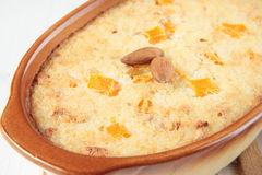 Rice pudding with chunks of pumpkin and almonds Stock Image