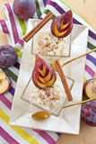 Rice pudding with cinnamon and plums Royalty Free Stock Photos
