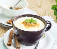 Rice Pudding with Cinnamon Powder and Mint Leaf Royalty Free Stock Images