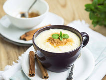 Rice Pudding with Cinnamon Powder and Mint Leaf Royalty Free Stock Photos