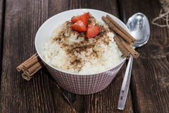 Rice Pudding with Cinnamon and Strawberries Royalty Free Stock Image