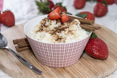 Rice Pudding with Cinnamon and Strawberries Stock Photography